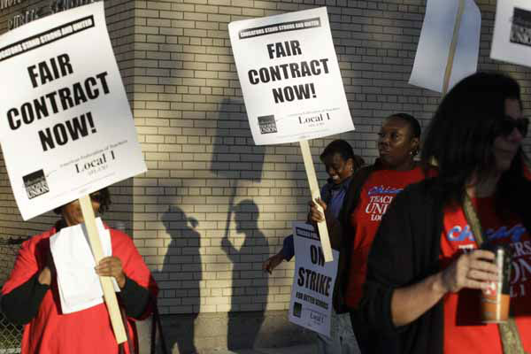 "<div class=""meta ""><span class=""caption-text "">Chicago teachers walk a picket line outside Benjamin Banneker Elementary School in Chicago, early Monday, Sept. 10, 2012, after they went on strike for the first time in 25 years. Union and district officials failed to reach a contract agreement despite intense weekend negotiations. (AP Photo/M. Spencer Green) (AP Photo/ M. Spencer Green)</span></div>"