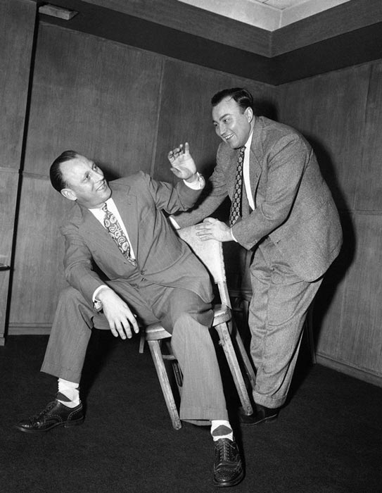 De Paul basketball coach Ray Meyer, right, tries to unseat Illinois basketball coach Harry Combes (1947-1967) as the two engage in a bit of horseplay at the weekly basketball writers' luncheon in Chicago, Jan. 22, 1952.  (AP Photo/Charles Knoblock)