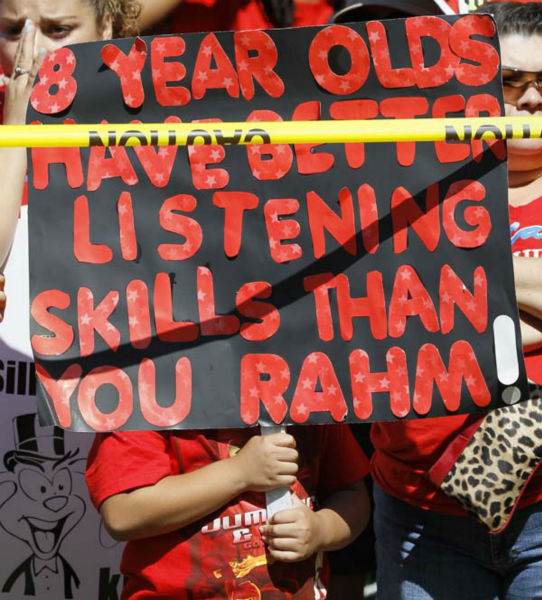 A young boy holds up a sign critical of Chicago mayor Rahm Emanuel during a rally of striking Chicago school teachers Saturday, Sept. 15, 2012, in Chicago. Union president Karen Lewis reminded the crowd that although there is a &#34;framework&#34; for an end to their strike, they still are on strike. &#40;AP Photo&#47;Charles Rex Arbogast&#41; <span class=meta>(AP Photo&#47; Charles Rex Arbogast)</span>