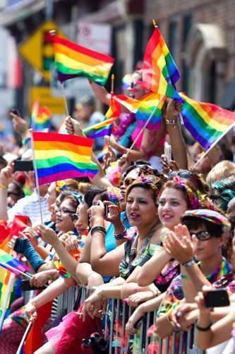 Spectators watch as parade floats and entertainers pass by at the Chicago Gay Pride Parade Sunday, June 30, 2013, in Chicago. &#40;AP Photo&#47;Scott Eisen&#41; <span class=meta>(AP Photo&#47; Scott Eisen)</span>