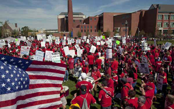 A large group of public school teachers rally at John Marshall Metropolitan High School on Wednesday, Sept. 12, 2012 in West Chicago. Teachers walked off the job Monday for the first time in 25 years over issues that include pay raises, classroom conditions, job security and teacher evaluations. &#40;AP Photo&#47;Sitthixay Ditthavong&#41; <span class=meta>(AP Photo&#47; Sitthixay Ditthavong)</span>