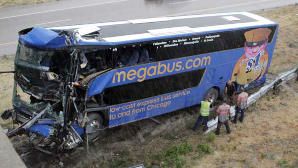"<div class=""meta ""><span class=""caption-text "">The wreckage of a Megabus is removed from the bridge support pilar that it slammed into after blowing a tire, Thursday, Aug. 2, 2012 in Litchfield, Ill. Illinois State Police Trooper Doug Francis said at least one person was killed in the afternoon wreck which was traveling from Chicago to Kansas City.   (AP Photo/Tom Gannam) (AP Photo/ Tom Gannam)</span></div>"
