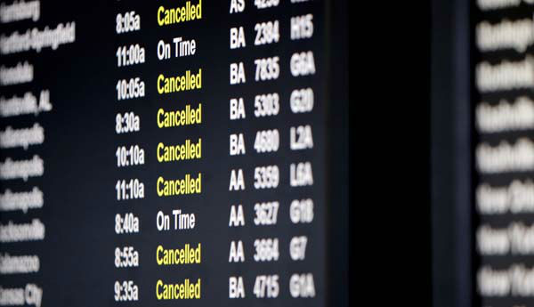 A screen displays flights information at O&#39;Hare International Airport in Chicago on Sunday, Jan. 5, 2014. Temperatures not seen in years are likely to set records in the coming days across the Midwest, Northeast and South, creating dangerous travel conditions and prompting church and school closures.  &#40;AP Photo&#47;Nam Y. Huh&#41; <span class=meta>(Photo&#47;Nam Y. Huh)</span>