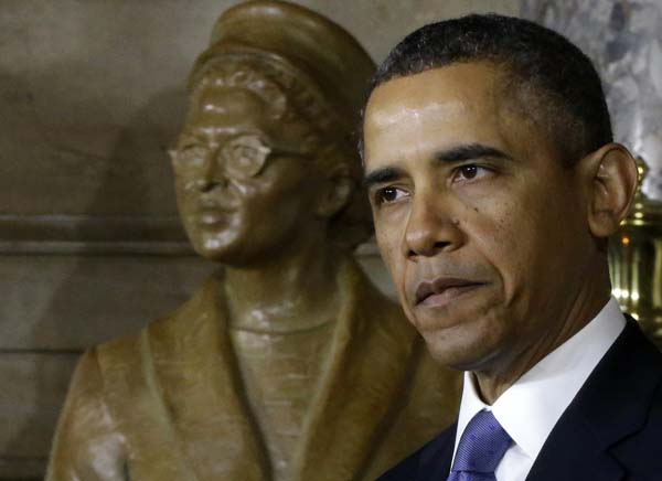 "<div class=""meta ""><span class=""caption-text "">President Barack Obama speaks at the unveiling of a statue of Rosa Parks, left, Wednesday, Feb. 27, 2013, on Capitol Hill in Washington.  (AP Photo/Charles Dharapak)</span></div>"