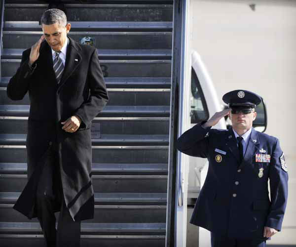 President Barack Obama salutes as he walks down the stairs of Air Force One upon his arrival at O&#39;Hare International Airport in Chicago, Friday, Feb. 15, 2013. The president traveled to Chicago to pitch his &#34;Ladders of opportunity&#34; economic plan, following his State of the Union address. &#40;AP Photo&#47;Paul Beaty&#41; <span class=meta>(AP Photo&#47; PAUL BEATY)</span>