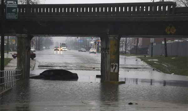 An abandoned car bobs in standing water under an overpass Thursday, April 18, 2013, in Chicago.  Blasts of torrential rain and widespread flooding forced authorities to shut segments of major expressways, and hundreds of flights were scrapped. &#40;AP Photo&#47;M. Spencer Green&#41; <span class=meta>(AP Photo&#47; M. Spencer Green)</span>