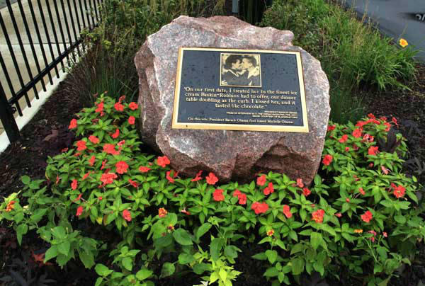 A 3,000-pound granite marker sits at the corner of Dorchester and 53rd Streets where President Barack Obama first kissed first lady Michele Obama Thursday, Aug. 16, 2012, in Chicago. The owners of a shopping center in Chicago&#39;s Hyde Park neighborhood installed the granite marker this week. The Obamas will celebrate their 20th wedding anniversary this October. &#40;AP Photo&#47;Charles Rex Arbogast&#41; <span class=meta>(AP Photo&#47; Charles Rex Arbogast)</span>
