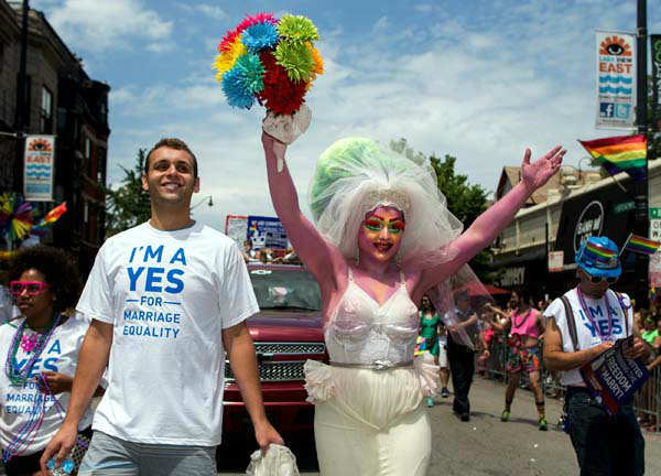Participants in the Chicago Gay Pride Parade react to the spectators in Chicago, Sunday, June 30, 2013. &#40;AP Photo&#47;Scott Eisen&#41; <span class=meta>(AP Photo&#47; Scott Eisen)</span>