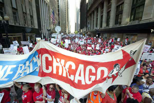 Thousands of public school teachers prepare to march for the second consecutive day outside the Chicago Board of Education district headquarters on Tuesday, Sept. 11, 2012 in Chicago. Teachers walked off the job Monday for the first time in 25 years over issues that include pay raises, classroom conditions, job security and teacher evaluations. &#40;AP Photo&#47;Sitthixay Ditthavong&#41; <span class=meta>(AP Photo&#47; Sitthixay Ditthavong)</span>