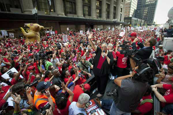 Chicago Teachers Union President Karen Lewis takes a break from negotiations over teachers&#39; contracts with the Chicago Board of Education to address a rally of thousands of public school teachers on Tuesday, Sept. 11, 2012 in downtown Chicago. Teachers walked off the job Monday for the first time in 25 years over issues that include pay raises, classroom conditions, job security and teacher evaluations. &#40;AP Photo&#47;Sitthixay Ditthavong&#41; <span class=meta>(AP Photo&#47; Sitthixay Ditthavong)</span>