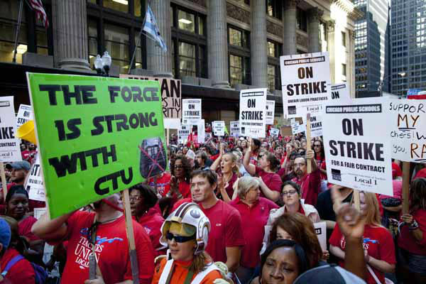 "<div class=""meta image-caption""><div class=""origin-logo origin-image ""><span></span></div><span class=""caption-text"">Thousands of public school teachers rally outside the Chicago Public Schools district headquarters on the first day of strike action over teachers' contracts on Monday, Sept. 10, 2012 in Chicago. For the first time in a quarter century, Chicago teachers walked out of the classroom Monday, taking a bitter contract dispute over evaluations and job security to the streets of the nation's third-largest city ? and to a national audience ? less than a week after most schools opened for fall. (AP Photo/Sitthixay Ditthavong) (AP Photo/ Sitthixay Ditthavong)</span></div>"