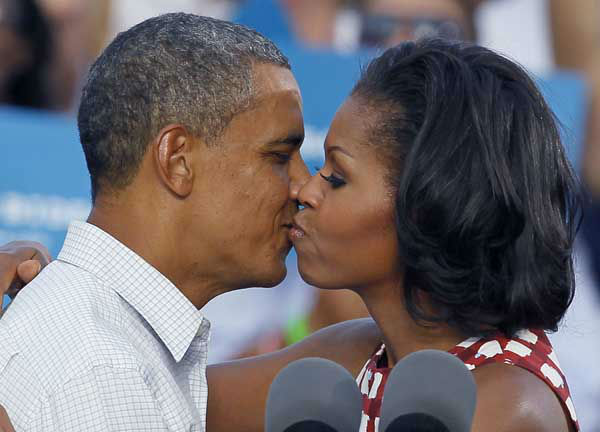 President Barack Obama, left, kisses first lady Michele Obama during a campaign stop Wednesday, Aug. 15, 2012, in Davenport, Iowa. &#40;AP Photo&#47;Charles Rex Arbogast&#41; <span class=meta>(AP Photo&#47; Charles Rex Arbogast)</span>