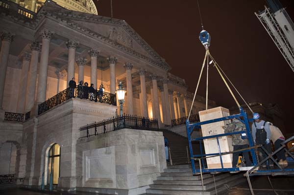 Riggers load a crate containing the bronze statue of Rosa Parks onto a basket suspended from a crane as it is delivered to the U.S. Capitol&#39;s Memorial Door, in Washington, Friday, Feb. 22, 2013, where it will join the U.S. Capitol Art Collection. Authorized by Public Law 109-116, as modified by Public Law 110-120, the Rosa Parks statue represents the first commission of a full-sized statue approved and funded by the U.S. Congress since 1873. It will be installed in National Statuary Hall in the United States Capitol on February 27, 2013.  <span class=meta>(AP Photo&#47;Cliff Owen)</span>