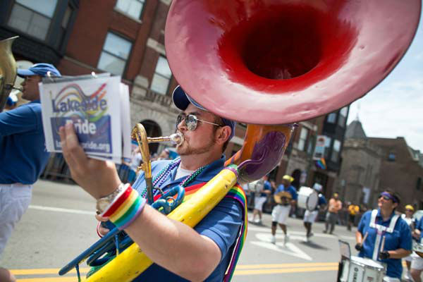 A musician reads his music while playing in the Chicago Gay Pride Parade in Chicago, Sunday, June 30, 2013.  &#40;AP Photo&#47;Scott Eisen&#41; <span class=meta>(AP Photo&#47; Scott Eisen)</span>