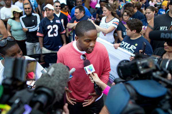 Grand Marshall for the Chicago Gay Pride Parade, former NFL football player Wade Davis speaks to reporters prior to the Chicago Gay Pride Parade in Chicago, Sunday, June 30, 2013. &#40;AP Photo&#47;Scott Eisen&#41; <span class=meta>(AP Photo&#47; Scott Eisen)</span>