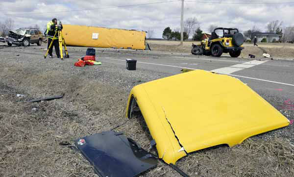 "<div class=""meta ""><span class=""caption-text "">Investigators gather evidence from the scene of a three vehicle accident, including a school bus where the driver of a Jeep Wrangler was killed on Friday, April 5, 2013, near Wadsworth, Ill.  Over two dozen school children were on the bus, most receiving minor injuries. (AP Photo/Jim Prisching) (AP Photo/ Jim Prisching)</span></div>"