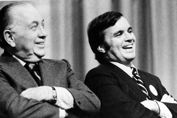 This Oct. 30, 1974 file photo shows Richard J. Daley, left, and his son, Richard M. Daley, attending a rally in Chicago. (AP Photo/File)