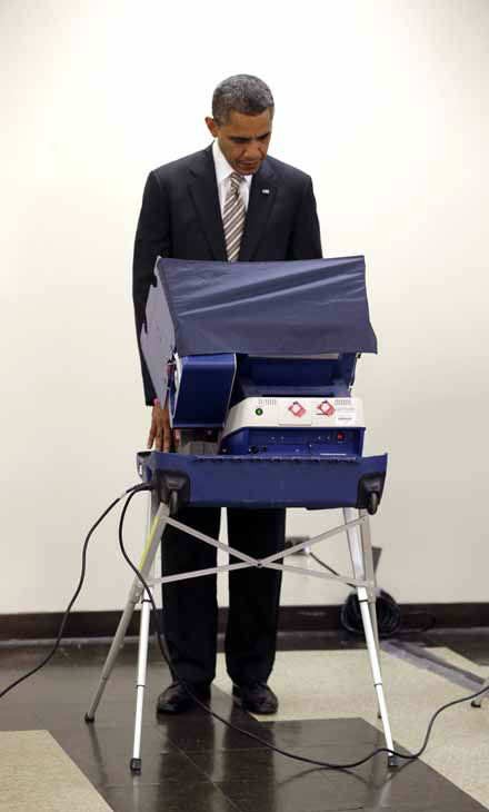 President Barack Obama casts his vote during early voting in the 2012 election at the Martin Luther King Community Center, Thursday, Oct. 25, 2012, in Chicago. &#40;AP Photo&#47;Pablo Martinez Monsivais&#41; <span class=meta>(AP Photo&#47; Pablo Martinez Monsivais)</span>