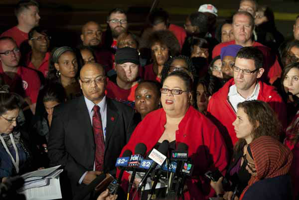 "<div class=""meta ""><span class=""caption-text "">Chicago Teachers Union President Karen Lewis, center, tells reporters at a news conference outside the union's headquarters that the city's 25,000 public school teachers will walk the picket line Monday morning after talks with the Chicago Board of Education failed to reach an agreement over teachers' contracts by the evening deadline on Sunday, Sept. 9, 2012 in Chicago. (AP Photo/Sitthixay Ditthavong) (AP Photo/ Sitthixay Ditthavong)</span></div>"