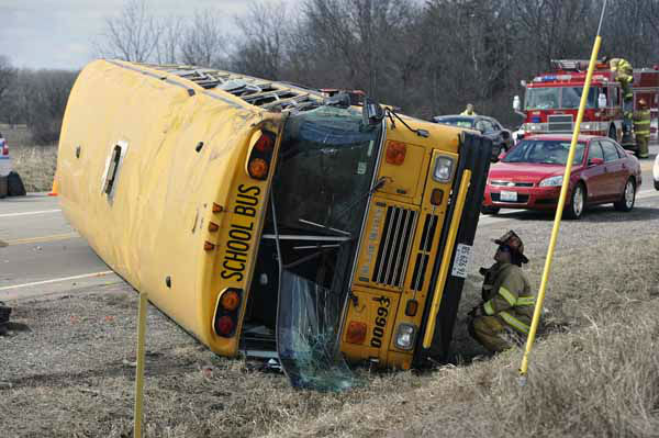 Investigators gather evidence from the scene of a three vehicle accident, including a school bus where the driver of a Jeep Wrangler was killed on Friday, April 5, 2013, near Wadsworth, Ill.  Over two dozen school children were on the bus, most receiving minor injuries. &#40;AP Photo&#47;Jim Prisching&#41; <span class=meta>(AP Photo&#47; Jim Prisching)</span>
