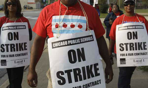 Smaller, more subdued groups of teachers picket outside Morgan Park High School in Chicago, Monday, Sept. 17, 2012, as a strike by Chicago Teachers Union members heads into its second week. Mayor Rahm Emanuel said he will seek a court order to force the city&#39;s teachers back into the classroom. &#40;AP Photo&#47;M. Spencer Green&#41; <span class=meta>(AP Photo&#47; M. Spencer Green)</span>