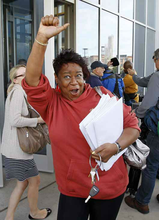 Stephanie Hayes, a member of the Chicago Teachers Union&#39;s House of Delegates celebrates after the delegates voted to suspend the strike against the school district Tuesday, Sept. 18, 2012, in Chicago. The city&#39;s teachers agreed to return to the classroom after more than a week on the picket lines, ending a spiteful stalemate with Mayor Rahm Emanuel that put teacher evaluations and job security at the center of a national debate about the future of public education. &#40;AP Photo&#47;Charles Rex Arbogast&#41; <span class=meta>(AP Photo&#47; Charles Rex Arbogast)</span>