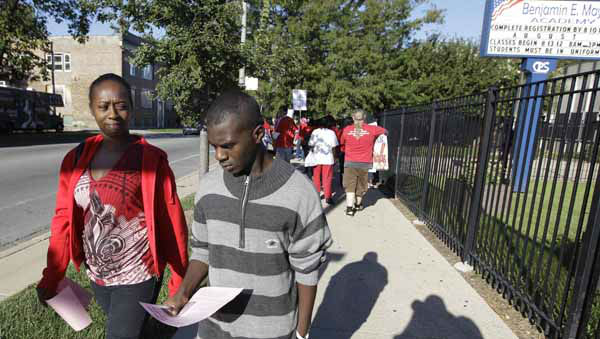 Dequita Wade walks her son Jerome Wade, 16, to Paul Robeson High School, one of the few schools open for a half day during the first day of a Chicago teachers strike, Monday, Sept. 10, 2012. Thousands of teachers walked off the job in the nation&#39;s third-largest school district for the first time in 25 years after union leaders announced they were far from resolving a contract dispute with school district officials. &#40;AP Photo&#47;M. Spencer Green&#41; <span class=meta>(AP Photo&#47; M. Spencer Green)</span>