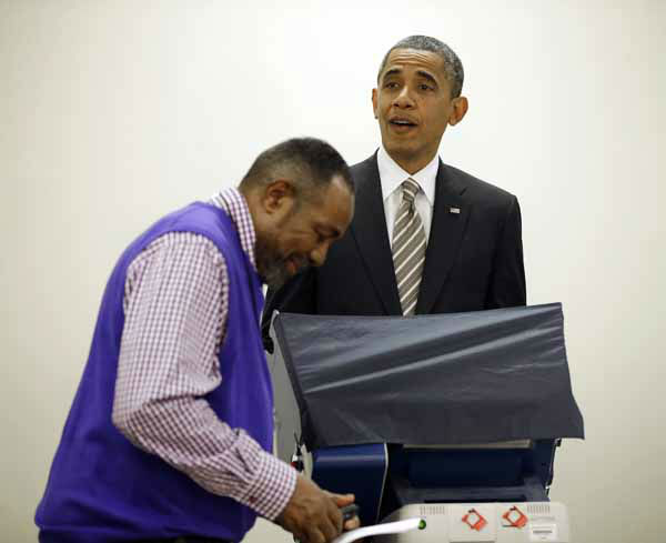 "<div class=""meta ""><span class=""caption-text "">President Barack Obama, right, reacts to election official Eli Selph's cell ringing as he casts his vote, during early voting, in the 2012 election at the Martin Luther King Community Center, Thursday, Oct. 25, 2012, in Chicago. (AP Photo/Pablo Martinez Monsivais) (AP Photo/ Pablo Martinez Monsivais)</span></div>"