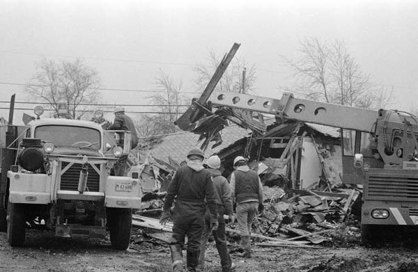"<div class=""meta ""><span class=""caption-text "">Workmen finish destruction of the home of serial killer John Wayne Gacy, Jr., April 11,1979, in an area west of Chicago. The bodies of 29 persons were unearthed on Gacy's property.  Gacy has been charged with murder on seven counts. (AP Photo/Charles Knoblock)</span></div>"