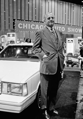 Chrysler Chairman Lee Iacocca stands while answering reporters questions at the Chicago Auto Show, Friday, Feb. 20, 1981 in Chicago.  (AP Photo)