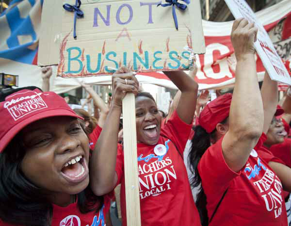 "<div class=""meta ""><span class=""caption-text "">Public school teachers cheer as Chicago Teachers Union President Karen Lewis, unseen, arrives unexpectedly to address a rally of thousands of teachers gathered for the second consecutive day outside the Chicago Board of Education district headquarters on Tuesday, Sept. 11, 2012 in Chicago. Teachers walked off the job Monday for the first time in 25 years over issues that include pay raises, classroom conditions, job security and teacher evaluations. (AP Photo/Sitthixay Ditthavong) (AP Photo/ Sitthixay Ditthavong)</span></div>"