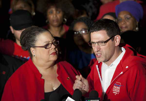 Chicago Teachers Union President Karen Lewis, left, listens to CTU Vice President Jesse Sharkey answer reporters questions at a news conference outside the union&#39;s headquarters on Sunday, Sept. 9, 2012 in Chicago. The CTU announced that the city&#39;s 25,000 public school teachers will walk the picket line for the first time in 25 years Monday morning after months of talks with the Chicago Board of Education failed to reach an agreement over teachers&#39; contracts by the Sunday night deadline. &#40;AP Photo&#47;Sitthixay Ditthavong&#41; <span class=meta>(AP Photo&#47; Sitthixay Ditthavong)</span>