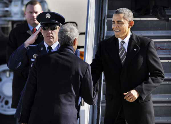 "<div class=""meta ""><span class=""caption-text "">President Barack Obama greets Chicago Mayor Rahm Emanuel as he walks off Air Force One after arriving at O'Hare International Airport in Chicago, Friday, Feb. 15, 2013. (AP Photo/Paul Beaty) (AP Photo/ PAUL BEATY)</span></div>"