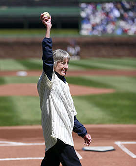 Sue Quigg, of Phoenix, and grandniece of former Chicago Cubs owner Charles Weeghman, walks out onto the field with a 100-year-old ball her grandmother Dessa Weeghman threw at a Chicago Federals game a century ago before the 100th anniversary of the first baseball game at Wrigley Field between the Arizona Diamondbacks and Cubs, Wednesday, April 23, 2014, in Chicago. &#40;AP Photo&#47;Charles Rex Arbogast&#41; <span class=meta>(Photo&#47;Charles Rex Arbogast)</span>