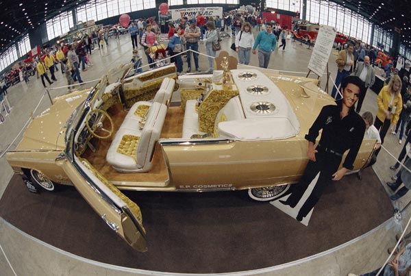 Crowds at an auto show look at a custom-made 1965 gold Cadillac Eldorado designed by George Barris and Elvis Presley in Chicago, Jan. 17, 1987.   (AP Photo/John Swart)