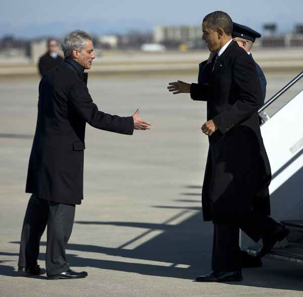 President Barack Obama, right, is greeted by Chicago Mayor Rahm Emanuel after arriving at Chicago O&#39;Hare International Airport in Chicago, Friday, Feb. 15, 2013. The president Obama went to Chicago to pitch his &#34;Ladders of opportunity&#34; economic plan that he laid out in his State of the Union address.  &#40;AP Photo&#47;Evan Vucci&#41; <span class=meta>(AP Photo&#47; Evan Vucci)</span>