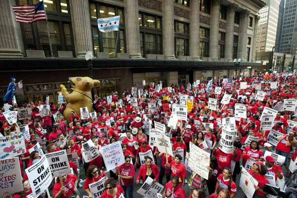 "<div class=""meta ""><span class=""caption-text "">Thousands of public school teachers rally for the second consecutive day outside the Chicago Board of Education district headquarters on Tuesday, Sept. 11, 2012 in Chicago. Teachers walked off the job Monday for the first time in 25 years over issues that include pay raises, classroom conditions, job security and teacher evaluations. (AP Photo/Sitthixay Ditthavong) (AP Photo/ Sitthixay Ditthavong)</span></div>"