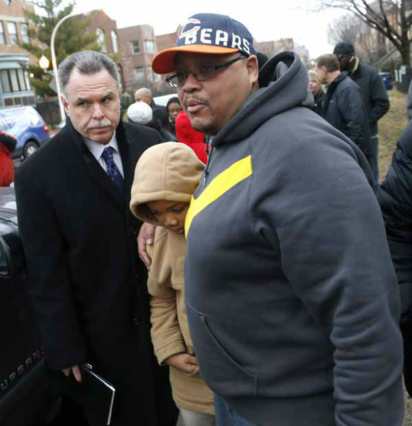 Chicago Police Superintendent Garry McCarthy, left, walks with Nathaniel Pendelton, left, and his son Nathaniel Jr. to  a news conference seeking help from the public in solving the murder of Pendelton&#39;s daughter Hadiya Wednesday, Jan. 30, 2013, in Chicago. &#40;AP Photo&#47;Charles Rex Arbogast&#41; <span class=meta>(AP Photo&#47; Charles Rex Arbogast)</span>