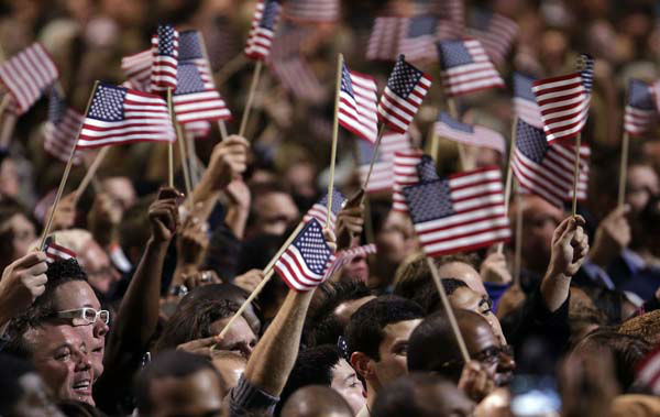 Supporters wave flags during President Barack Obama&#39;s election night party Tuesday, Nov. 6, 2012, in Chicago. President Obama defeated Republican challenger former Massachusetts Gov. Mitt Romney. &#40;AP Photo&#47;M. Spencer Green&#41; <span class=meta>(AP Photo&#47; M. Spencer Green)</span>