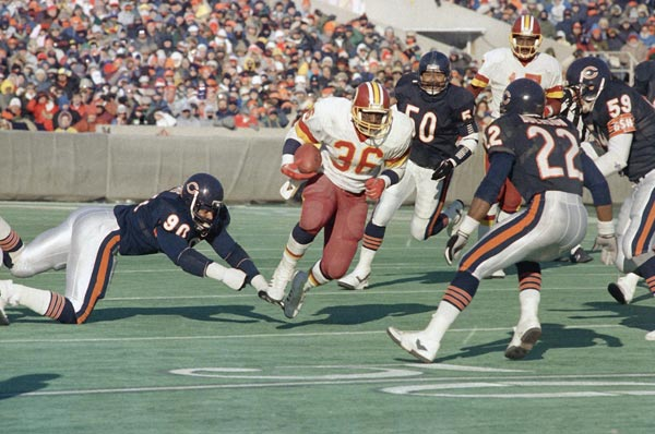Washington Redskins Timmy Smith (36) picks up yardage as he is pursued by Chicago Bears Al Harris (90), Mike Singletary (59) and Dave Duerson (22) during the fourth quarter of Washington's 21-17 win over the Bears in Chicago, Sunday, Jan. 11, 1988. (AP Photo/Mark Elias)