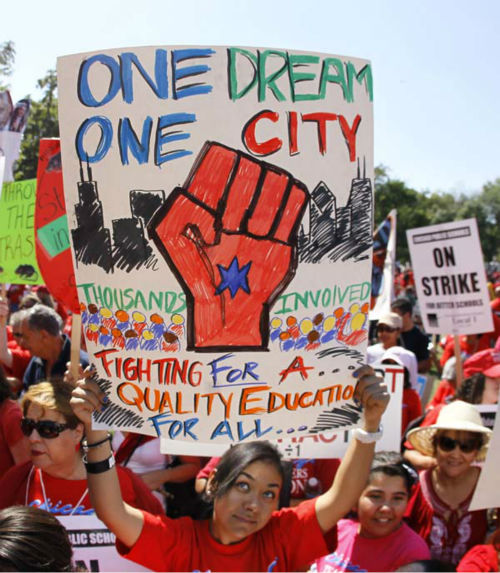 "<div class=""meta image-caption""><div class=""origin-logo origin-image ""><span></span></div><span class=""caption-text"">A woman holds up a sign during a rally of striking Chicago school teachers Saturday, Sept. 15, 2012, in Chicago. Union president Karen Lewis reminded the crowd that although there is a ""framework"" for an end to their strike, they still are on strike.(AP Photo/Charles Rex Arbogast) (AP Photo/ Charles Rex Arbogast)</span></div>"