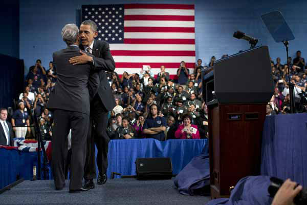 Chicago Mayor Rahm Emanuel, left, greets President Barack Obama after introducing him at Hyde Park Academy on Friday, Feb. 15, 2013, in Chicago. Obama is traveling to promote the economic and educational plan he laid out in his State of the Union address.  &#40;AP Photo&#47;Evan Vucci&#41; <span class=meta>(AP Photo&#47; Evan Vucci)</span>