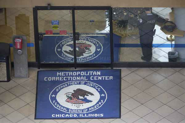 "<div class=""meta ""><span class=""caption-text "">A Chicago police officer stands guard in the lobby of the Metropolitan Correctional Center Tuesday, Dec. 18, 2012, in Chicago. Two convicted bank robbers used a knotted rope or bed sheets to escape from the federal prison window high above downtown Chicago early Tuesday, a week after one of them made a courtroom vow of retribution, to federal judge. The escape occurred sometime between 5 a.m. and 8:45 a.m. when the inmates were discovered missing, Chicago Police Sgt. Mark Lazarro said. Hours later, what appeared to be a rope, knotted at six-foot intervals, could be seen dangling into an alley from a window of the Metropolitan Correctional Center approximately 20 stories above the ground. (AP Photo/M. Spencer Green) (AP Photo/ M. Spencer Green)</span></div>"