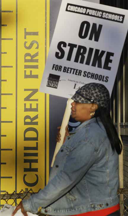 "<div class=""meta ""><span class=""caption-text "">Chicago teacher Alma Hill walks a picket line outside Benjamin Banneker Elementary School in Chicago, Monday, Sept. 10, 2012, after the teachers went on strike for the first time in 25 years. Union and district officials failed to reach a contract agreement despite intense weekend negotiations. (AP Photo/M. Spencer Green) (AP Photo/ M. Spencer Green)</span></div>"