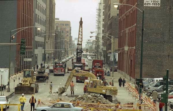 Workers begin to dig a connection between the water-filled freight tunnel and a lower deep tunnel beneath the streets of Chicago at Jefferson and Monroe Streets, April 14, 1992. <span class=meta>(AP Photo)</span>
