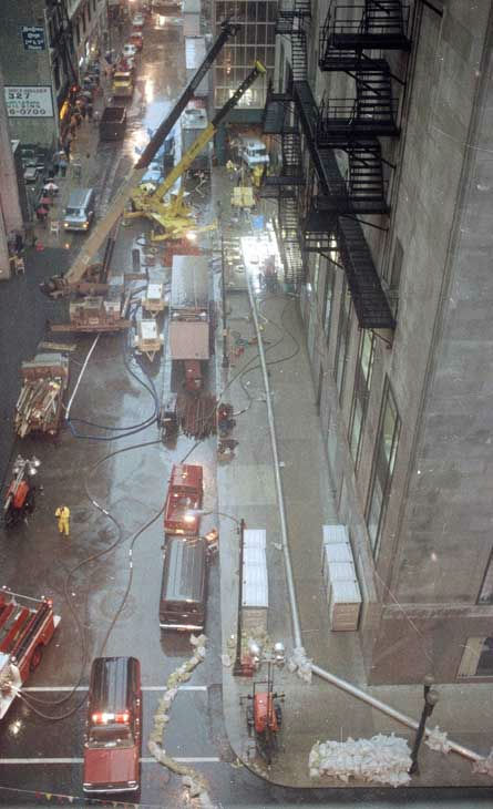 Water is pumped out of the basement of the Chicago Board of Trade, right, April 15, 1992. <span class=meta>(AP Photo)</span>