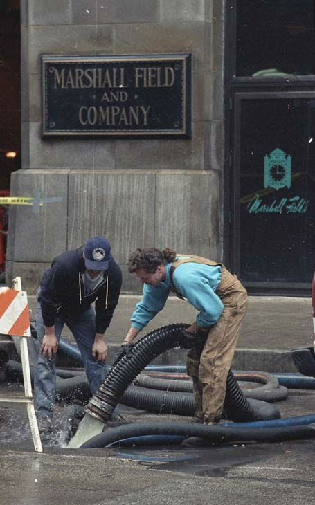 Workers drain water from Marshall Fields&#39; flagship store on State Street in downtown Chicago, April 17, 1992. <span class=meta>(AP Photo)</span>