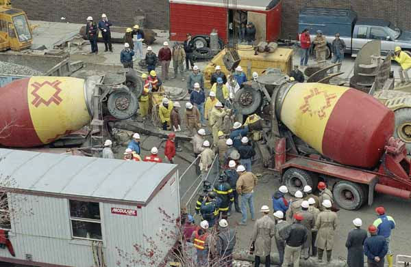 "<div class=""meta ""><span class=""caption-text "">Workers prepare to pour cement into a shaft that leads to a flooded tunnel in Chicago in an attempt to block the flow from the Chicago River, April 18, 1992. (AP Photo)</span></div>"