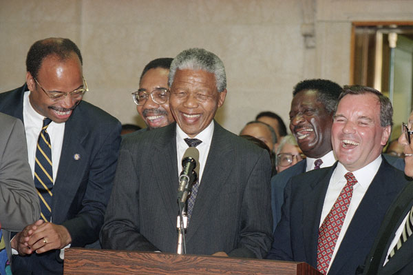 African National Congress President Nelson Mandela, center, is joined Mel Reynolds and Bobby Rush, Emil Jones, and Chicago Mayor Richard M. Daley during a welcoming ceremony Tuesday, July 6, 1993 in Chicago  (AP Photo/Marl Elias)