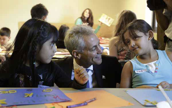 Chicago Mayor Rahm Emanuel visits with students Jacquelina Mena, left, and Brenda Pena at Maranatha Church in Chicago, Monday, Sept. 10, 2012, where students were being provided structured activities in their community and safe environment during a teachers strike. Thousands of Chicago Public School teachers walked off the job Monday in the nation&#39;s third-largest school district for the first time in 25 years after union leaders announced they were far from resolving a contract dispute with school district officials. &#40;AP Photo&#47;M. Spencer Green&#41; <span class=meta>(AP Photo&#47; M. Spencer Green)</span>